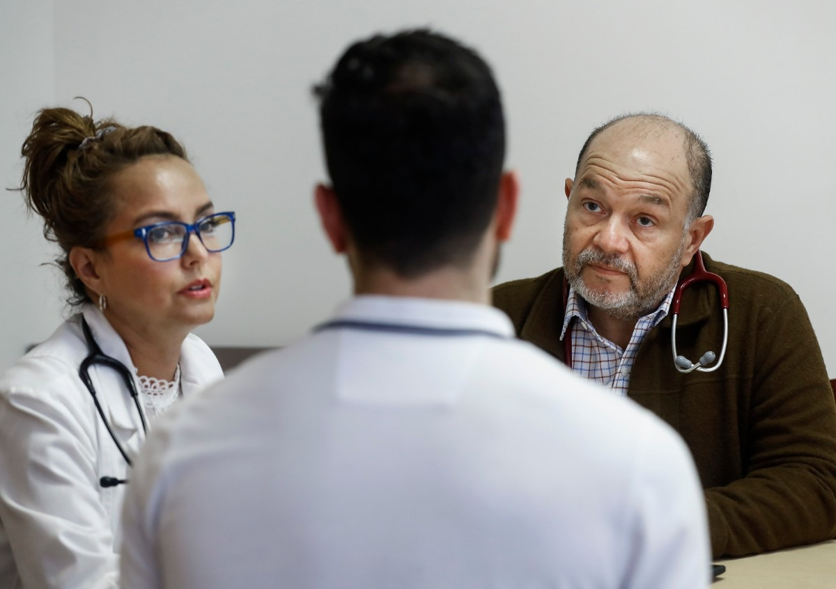 <strong>Dar Salud Care founder and CEO Dr. Pedro Velasquez-Mieyer (right) chats about patient care with team members Claudia Neria, Director of Clinical Practice (left), and Walid Mohammad, Director of Pharmacy, on Thursday, May 28, 2020.</strong> (Mark Weber/Daily Memphian)