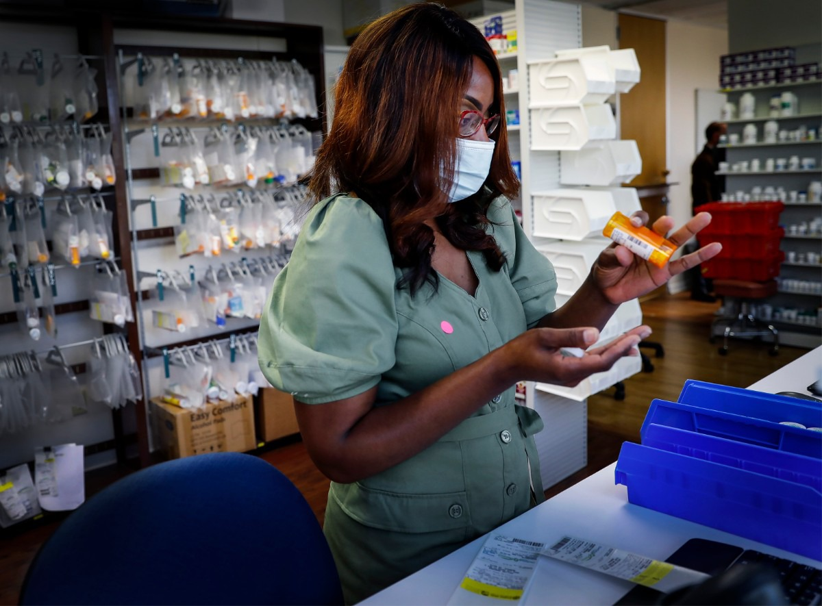<strong>Dar Salud Care pharmacist Kimberly Brooks fills patient prescriptions orders on Thursday, May 28, 2020.</strong> (Mark Weber/Daily Memphian)