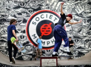 <strong>Skater Adrian Akin (right) grinds one of the rails at Society Skatepark &amp; Coffee in Binghampton. The business received a $5,000 grant Friday, May 29, to help offset some business losses caused by the COVID-19 pandemic.</strong> (Daily Memphian file)