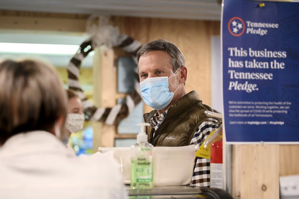 <strong>Gov. Bill Lee speaks with a shopkeeper in McEwen, Tennessee, on May 8 as Lee toured small businesses affected by the coronavirus.</strong> (Courtesy of TN.gov)