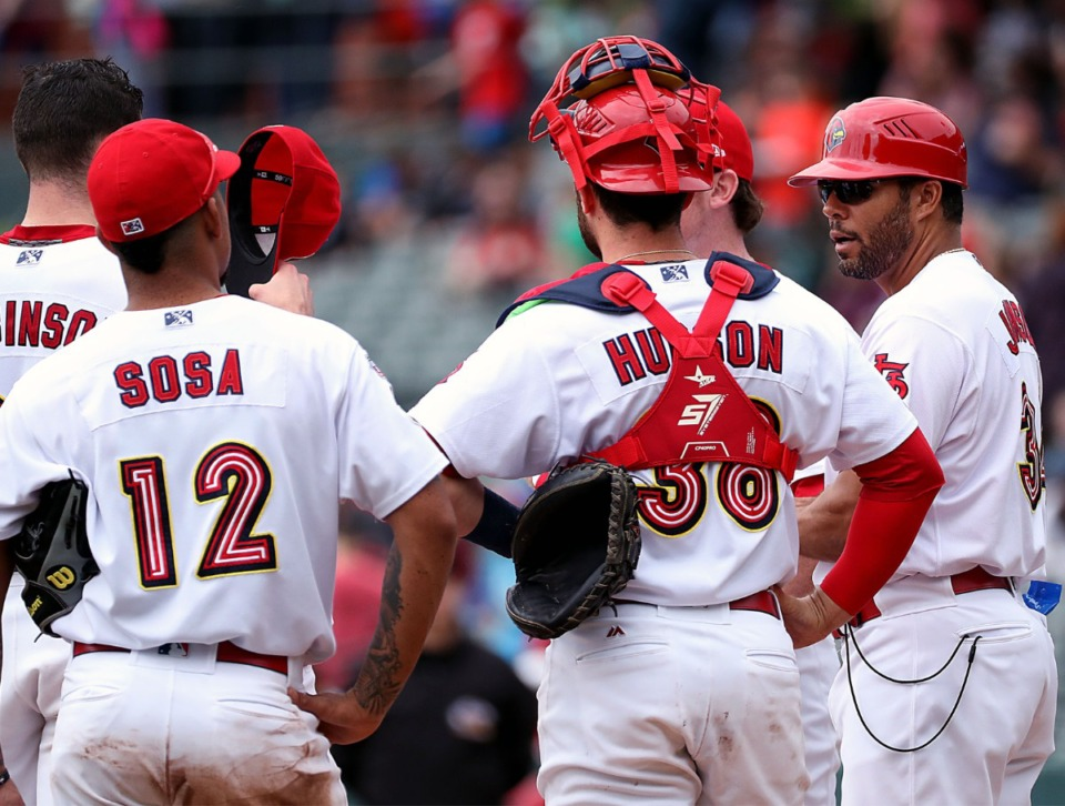 <strong>Memphis Redbirds manager Ben Johnson (far right) talks to his players during an April 8, 2019,&nbsp; game.</strong>&nbsp;<strong>Johnson, who is of mixed race, rides herd on a bunch of young players of every hue.</strong> (Patrick Lantrip/Daily Memphian file)