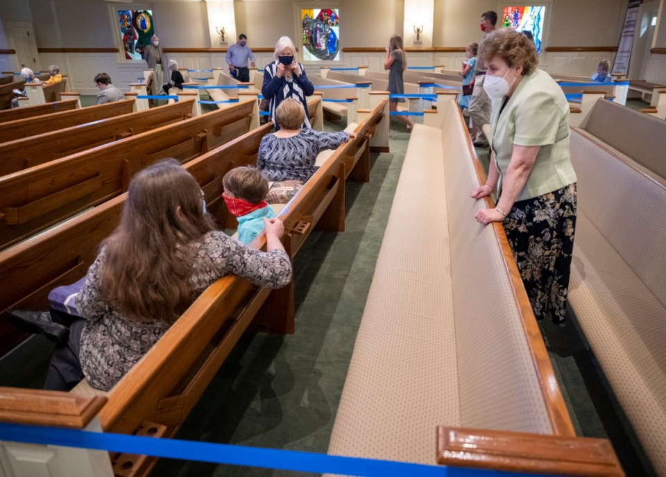 <strong>Diane Trubic (right) maintains her distance while visiting with other people in the Sunday, May 31,&nbsp; service at Ridgeway Baptist Church.</strong> (Greg Campbell/Special to The Daily Memphian)