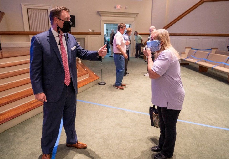 <strong>Pastor Ashley Ray speaks to a member after the service at Ridgeway Baptist Church on Sunday May 31. Ridgeway Baptist held its first in-person service since the stay-at-home order for COVID-19.</strong> (Greg Campbell/Special to The Daily Memphian)