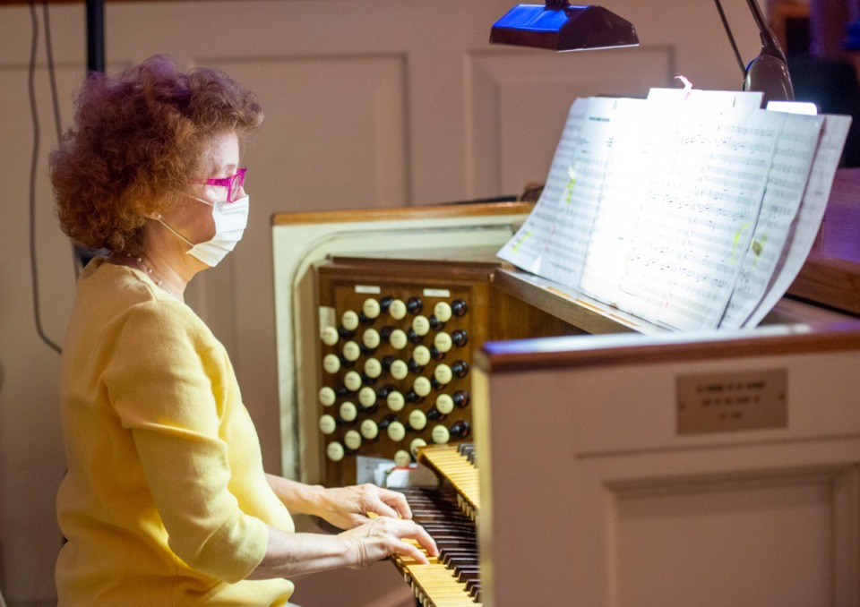<strong>Ridgeway Baptist Church organist, Michelle Brown, wears her facemask during the church's first in-person service on Sunday May 31.</strong> (Greg Campbell/Special to The Daily Memphian)