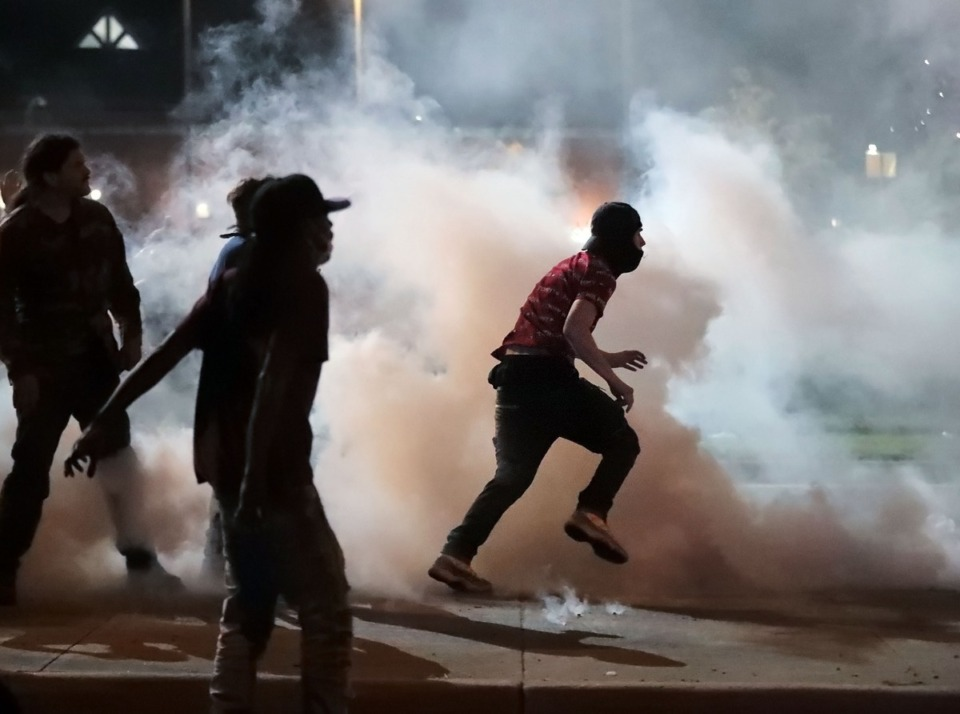 <strong>Protesters throw smoke bombs back at the Shelby County Sheriff's Deputies during a protest on Sunday, May 31, over the Minneapolis killing of George Floyd.</strong> (Patrick Lantrip/Daily Memphian)