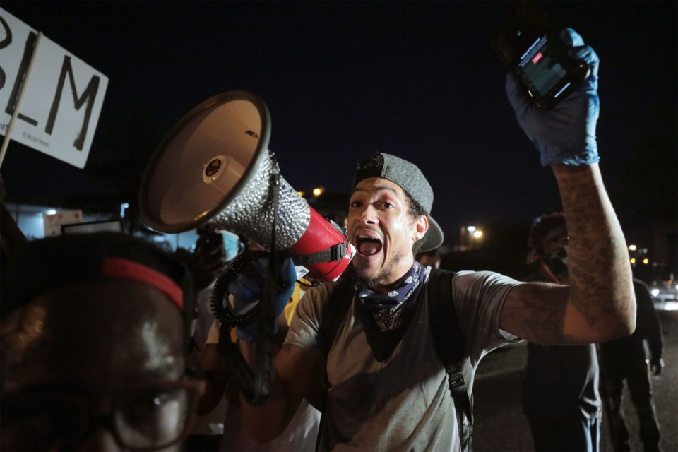 <strong>Protestors celebrate after eluding authorities and stopping traffic along Interstate 55 in Memphis, Tennessee during a protest over the murder of George Floyd May 31, 2020.</strong> (Patrick Lantrip/Daily Memphian)