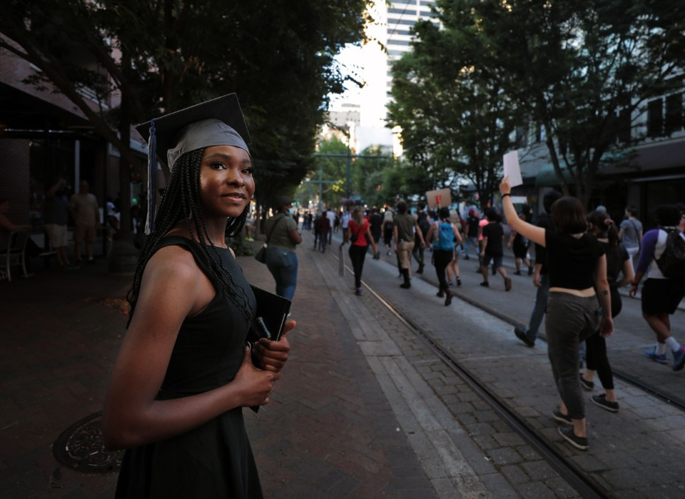 <strong>Recent Northwest Community College graduate Nyaisha Doyle cheers on protestors marching down Main Street in Memphis, Tennessee during a protest over the murder of George Floyd May 31, 2020.</strong> (Patrick Lantrip/Daily Memphian)