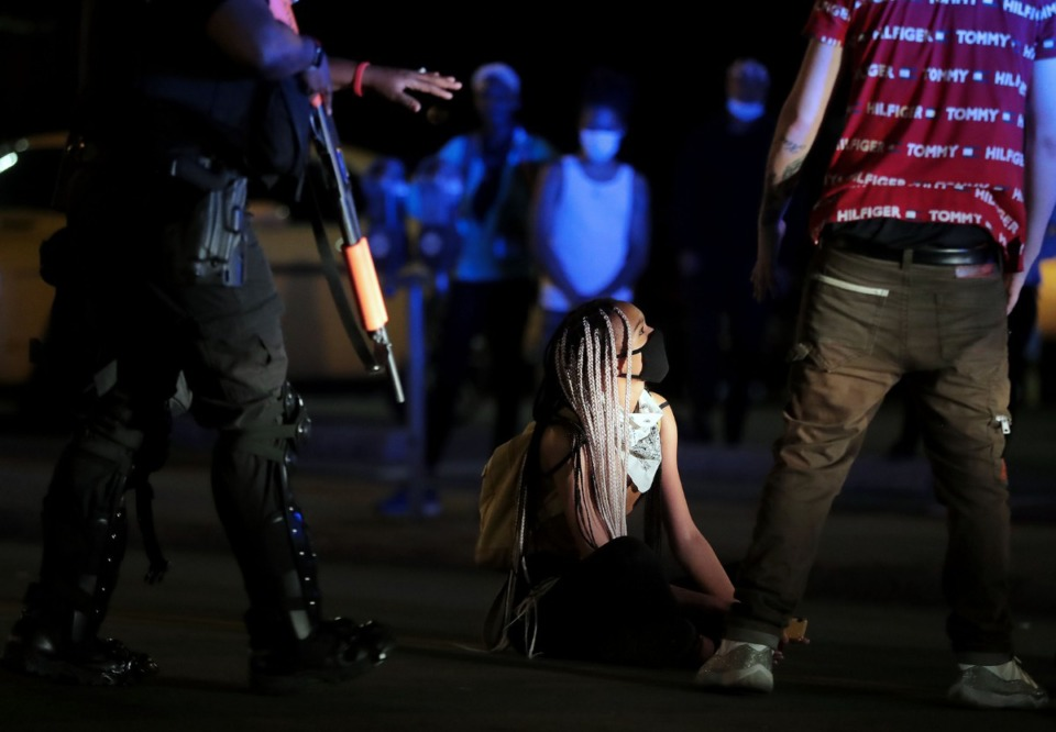 <strong>A protester refuses to move out of the street during the waning moments of a protest in Memphis on Monday, June 1, over the death in Minneapolis of George Floyd.</strong> (Patrick Lantrip/Daily Memphian)
