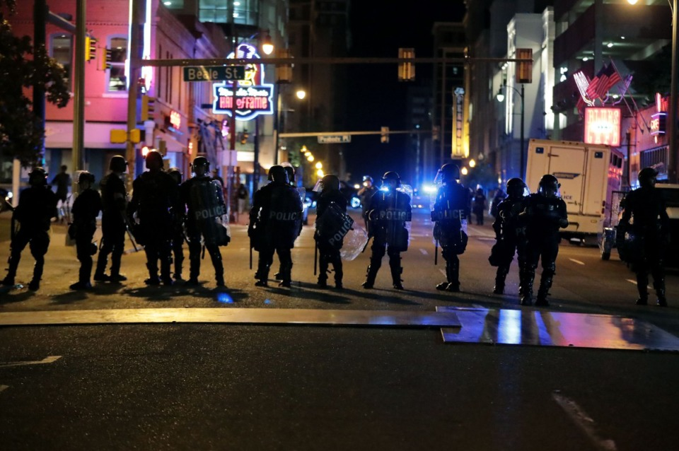 <strong>Police stand off against the last remnants of protesters early Monday, June 1.</strong> (Patrick Lantrip/Daily Memphian)
