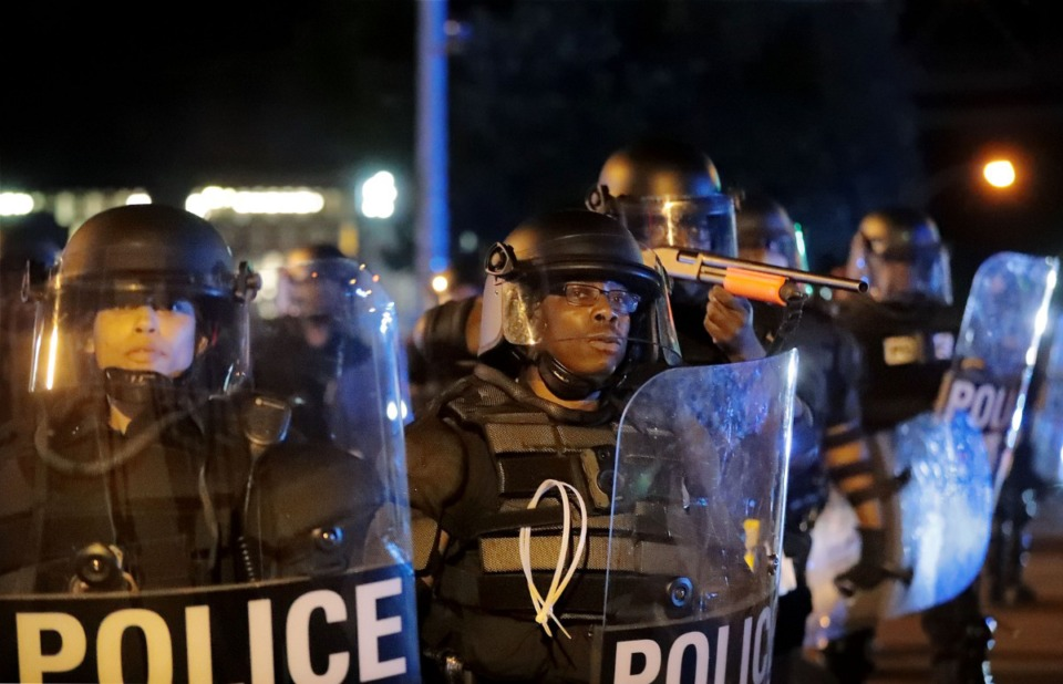 <strong>Memphis Police officers face off against a group of protesters in the early-morning hours of Monday, June 1.</strong> (Patrick Lantrip/Daily Memphian)