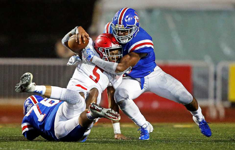 <strong>MUS' Dorian Hopkins (right) and Nash Stewart (76) tackle Brentwood Academy's Tomario Pleasant (5) during their Division 2-AAA championship game Friday, Nov. 30, in Cookeville, Tenn. Pleasant&nbsp;finished with 181 yards on 32 carries while earning game MVP honors.</strong>&nbsp;(Wade Payne/Special to The Daily Memphian)
