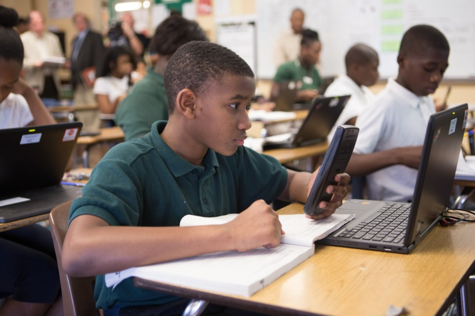 <strong>Sherwood Middle 8th Grader Devin Donerson checks his work on an algebra problem before submitting his answer into virtual classroom software, which allows teacehrs to see student work in real-time.</strong> (Daily Memphian file)