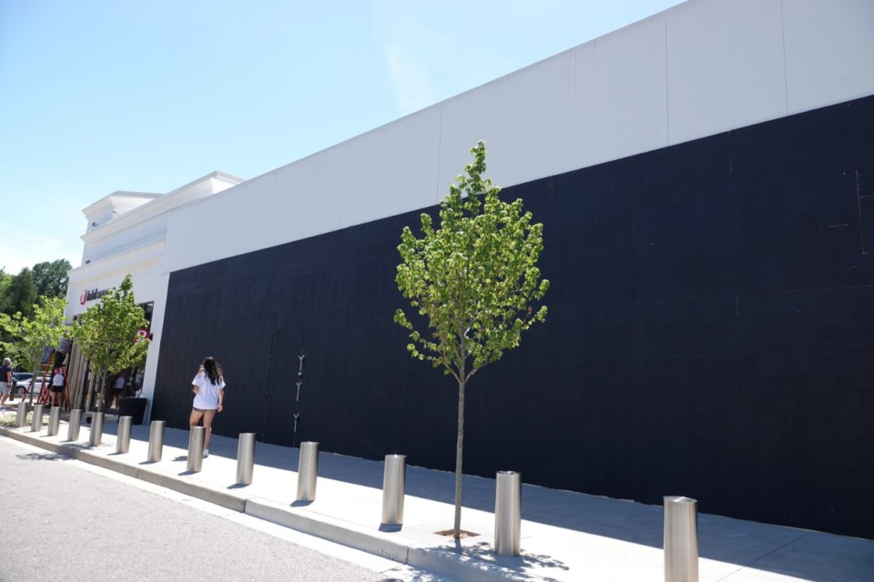 <strong>The Apple Store in the Shops of Saddle Creek in Germantown remained boarded up on Monday. June 1.&nbsp;<span>The city of Germantown set a curfew Monday night in the wake of&nbsp;</span>protests in response to the death of George Floyd while in the custody of the Minneapolis police.</strong> (Karen Pulfer Focht/Special to the Daily Memphian)