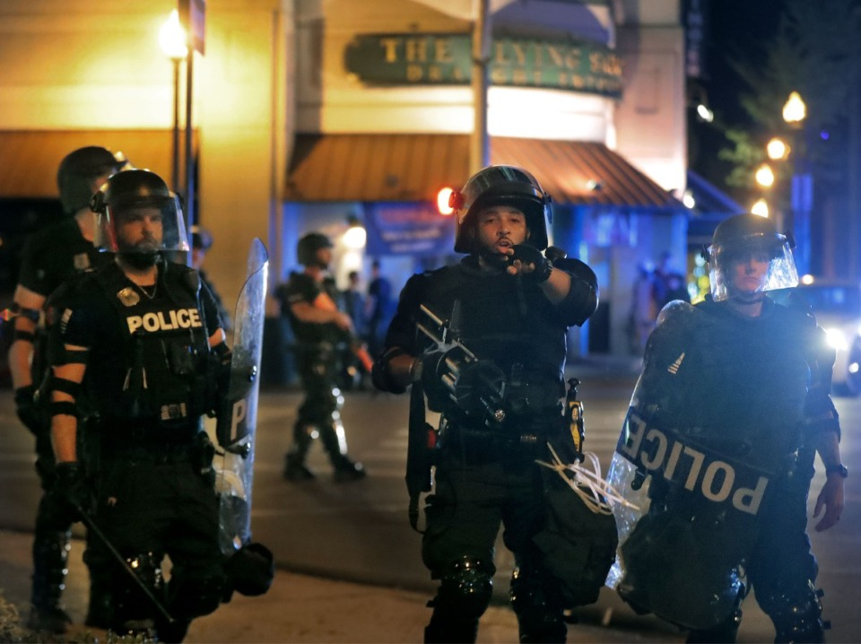 <strong>Memphis Police officers in riot gear try to clear the streets Downtown during a protest over the death of George Floyd June 1, 2020.</strong> (Patrick Lantrip/Daily Memphian)