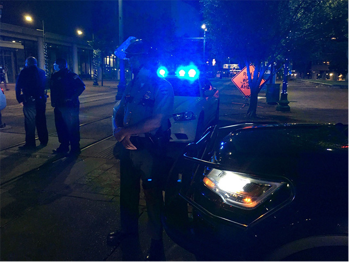 """<strong>Around 8:30 the protest moved to Poplar Avenue. """"We come in peace,"""" the protesters told police.</strong> (Daily Memphian)"""