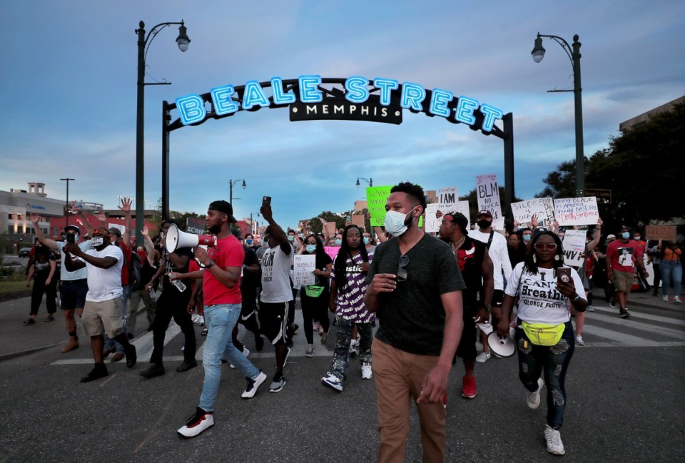 <strong>Protesters march under the Beale Street sign June 1, 2020. </strong>(Patrick Lantrip/Daily Memphian)