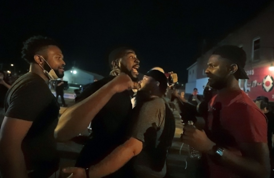 <strong>Darin Abston (left) confronts Devante Hill over the direction of the protest June 1, 2020.</strong> (Patrick Lantrip/Daily Memphian)