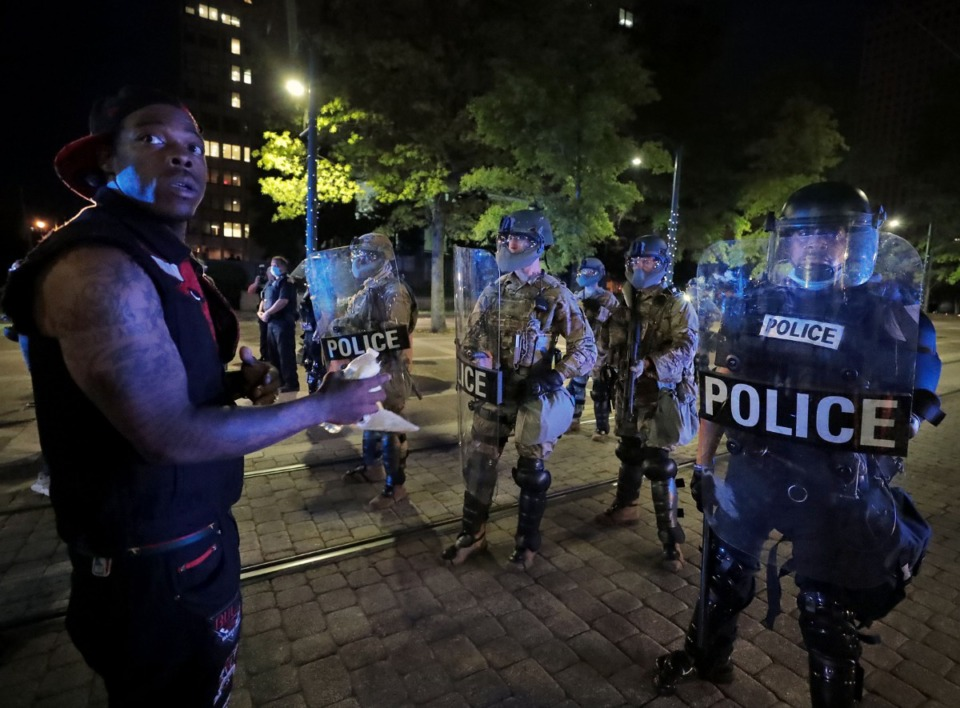<strong>A protestors unsuccessfully asks the members of the National Guard to lower their weapons while protestors peacefully pass down Poplar Avenue Jiune 1, 2020.</strong> (Patrick Lantrip/Daily Memphian)