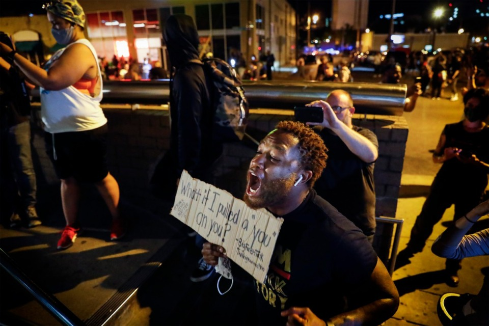 <strong>A protester yells at Memphis Police officers, who are inside the Shelby County Criminal Justice Center in Memphis on Monday, June 1, 2020, during a protest over the Minneapolis killing of George Floyd.</strong> (Mark Weber/Daily Memphian)