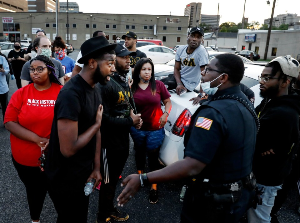 <strong>Activist Darin Abston (left) confronts a Memphis Police officers in Memphis on Monday, June 1, 2020. Protesters during a protest over the Minneapolis killing of George Floyd.</strong> (Mark Weber/Daily Memphian)