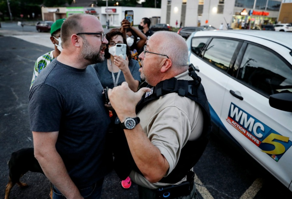 <strong>Activist Hunter Dempster (left) stands chest to chest while confronting a security guard hired by WMC-TV in Memphis on Monday, June 1, 2020, during a protest over the Minneapolis killing of George Floyd.</strong> (Mark Weber/Daily Memphian)