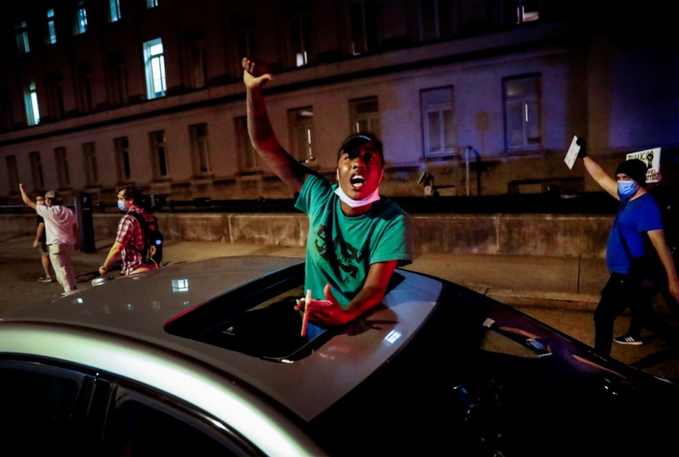 <strong>Jaz Flowers stand through her car&rsquo;s sunroof as protesters peacefully march by her in Memphis on Monday, June 1, 2020, during a protest over the Minneapolis killing of George Floyd.</strong> (Mark Weber/Daily Memphian)