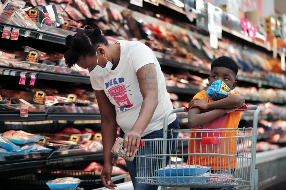 <strong>Ardarius Lowrey and his mother, Shennika Caples, shop at Superlo Foods in East Memphis during May.</strong> (Patrick Lantrip/Daily Memphian)