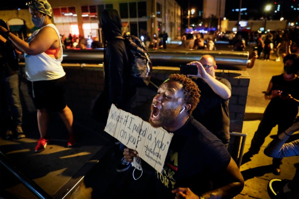 <strong>A protester yells at Memphis Police officers who are inside the Shelby County Criminal Justice Center in Memphis on Monday, June 1. Monday was the first night of a citywide curfew in Memphis.</strong> (Mark Weber/Daily Memphian)