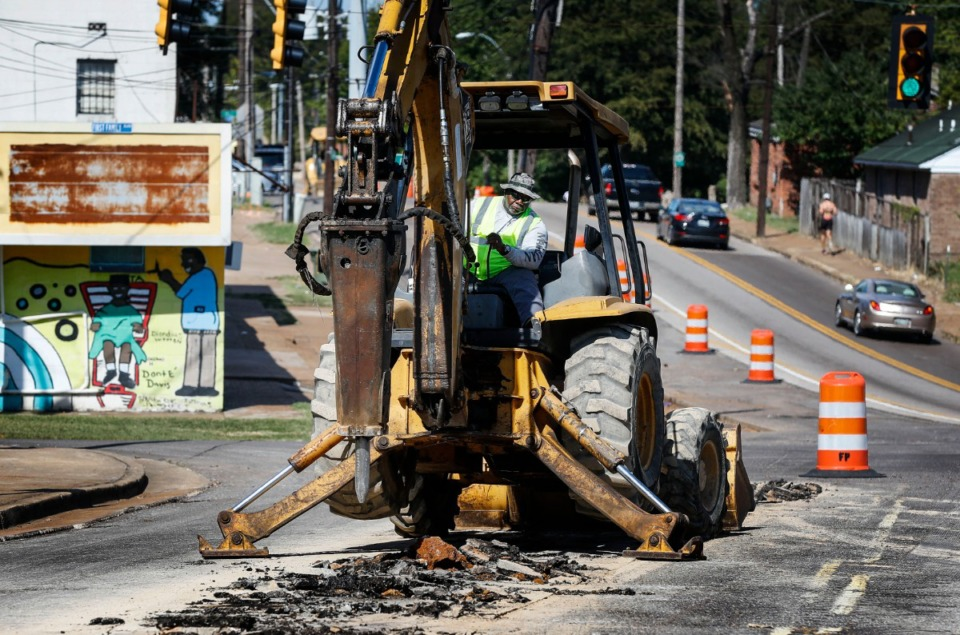 <strong>Michael Crittley, with Ferrell Paving, breaks up the concrete road along Tillman Ave. to make way for the new Hampline bike lane on Wednesday, Oct. 9, 2019.</strong> (Mark Weber/Daily Memphian)