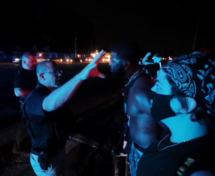 <strong>Darin Abston Jr. talks with a Memphis police officer after a protest shut down Germantown Parkway June 2, 2020.</strong> (Patrick Lantrip/Daily Memphian)