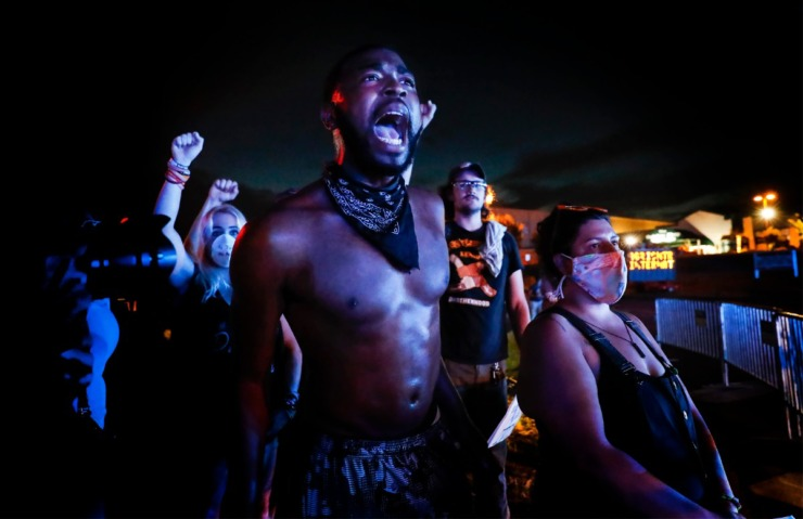 <strong>Activist Darin Abston (middle) yells at Memphis police officers on Germantown Parkway on Tuesday, June 2, 2020.</strong> (Mark Weber/Daily Memphian)