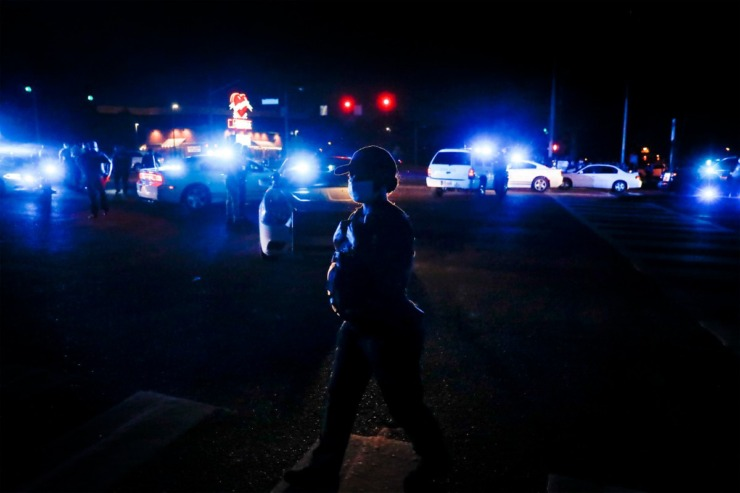 <strong>Memphis police officers secure Germantown Parkway after protesters block traffic on Tuesday, June 2, 2020.</strong> (Mark Weber/Daily Memphian)