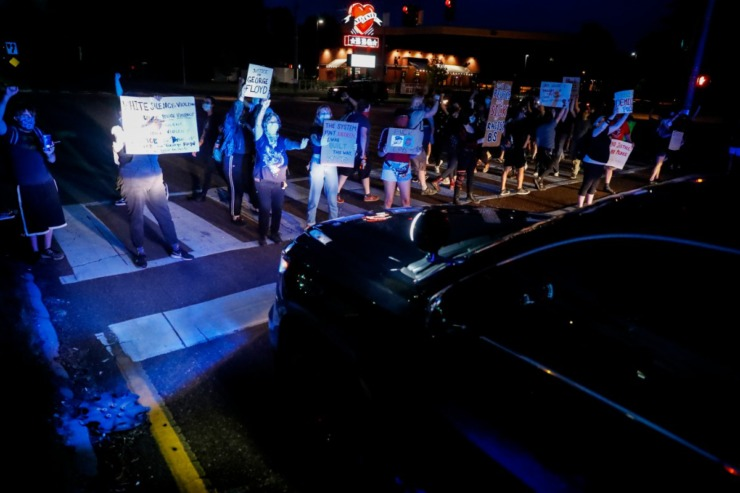 <strong>Protesters block a Memphis Police Department car while standing in the middle of Germantown Parkway on Tuesday, June 2, 2020.</strong> (Mark Weber/Daily Memphian)