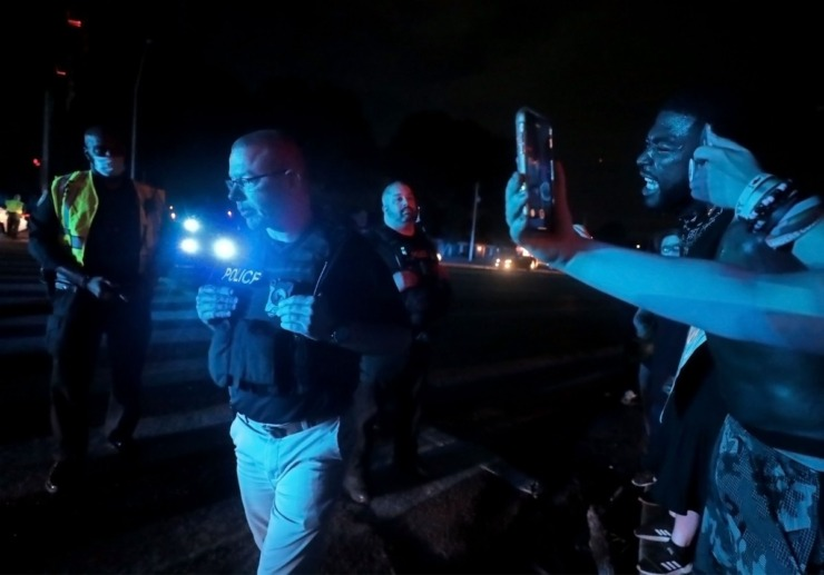 <strong>A Memphis Police officer walks away during the protest on Germantown Parkway June 2, 2020.</strong> (Patrick Lantrip/Daily Memphian)
