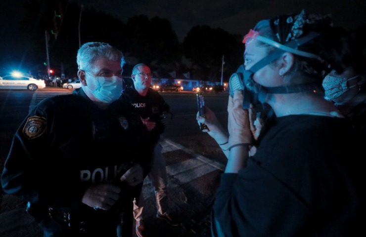 <strong>A Memphis police officer talks to the protesters who shut down Germantown Parkway June 2, 2020.</strong> (Patrick Lantrip/Daily Memphian)