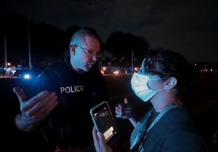 <strong>Memphis police officers talk to protest leaders on Germantown Parkway on June 2, 2020.</strong> (Patrick Lantrip/Daily Memphian)