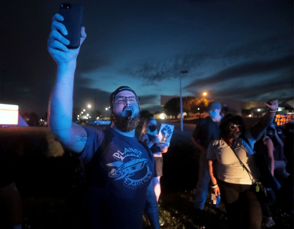 "<strong>Protesters chant ""no justice, no peace during a protest that shut down Germantown Parkway June 2, 2020 over the murder of George Floyd.</strong> (Patrick Lantrip/Daily Memphian)"