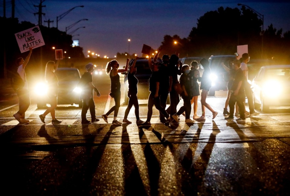 <strong>Protesters walking in front of cars on Germantown Road while blocking traffic on Tuesday, June 2, 2020, during a protest over the Minneapolis killing of George Floyd.</strong> (Mark Weber/Daily Memphian)