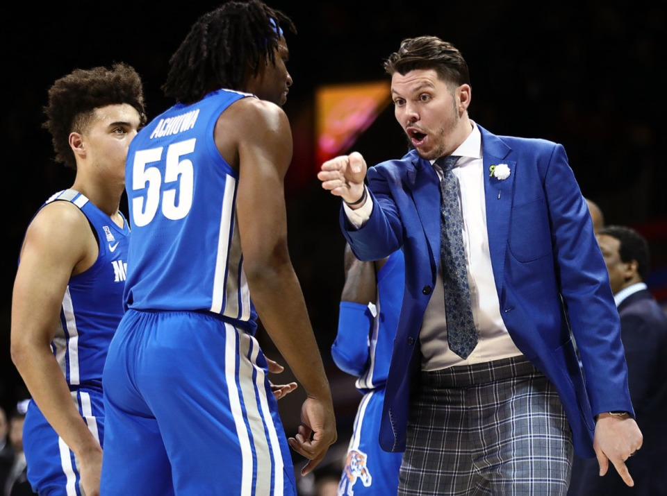 <strong>University of Memphis assistant coach Mike Miller (shown with Precious Achiuwa&nbsp; and Lester Quinones during a Feb. 25 game) has left the program. Miller spent two seasons with the Tigers.</strong> (Patrick Lantrip/Daily Memphian file)