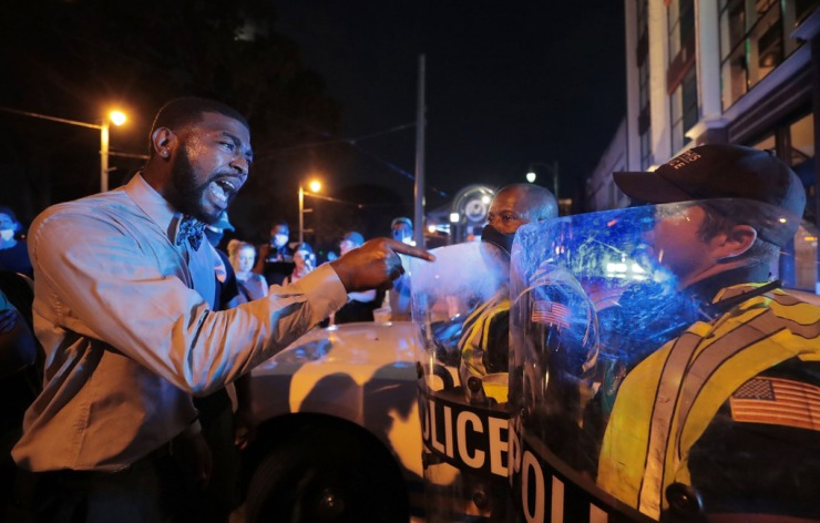 <strong>Darin Abston Jr., with the Memphis People Coalition, demands an apology from a Memphis police officer he says almost hit him with a squad car earlier in the week during the eighth day of protesting over the murder of George Floyd June 3, 2020.</strong> (Patrick Lantrip/Daily Memphian)