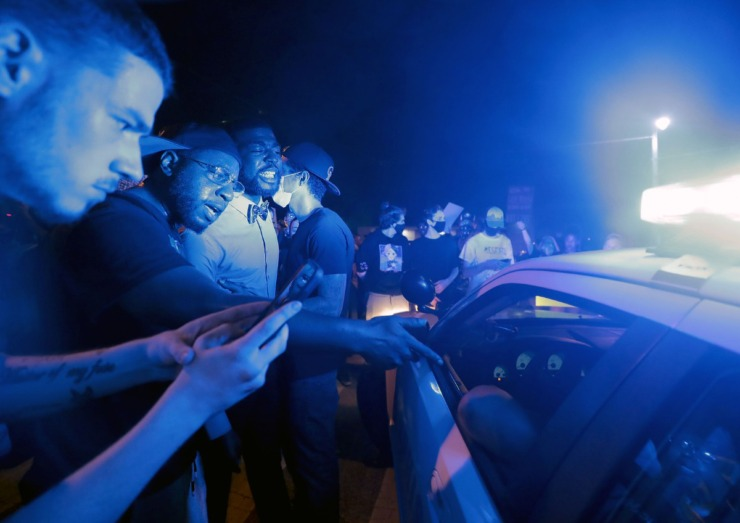 <strong>Darin Abston Jr., with the Memphis People Coalition, argues with a Memphis police officer he says almost hit him with a squad car earlier in the week.</strong> (Patrick Lantrip/Daily Memphian)