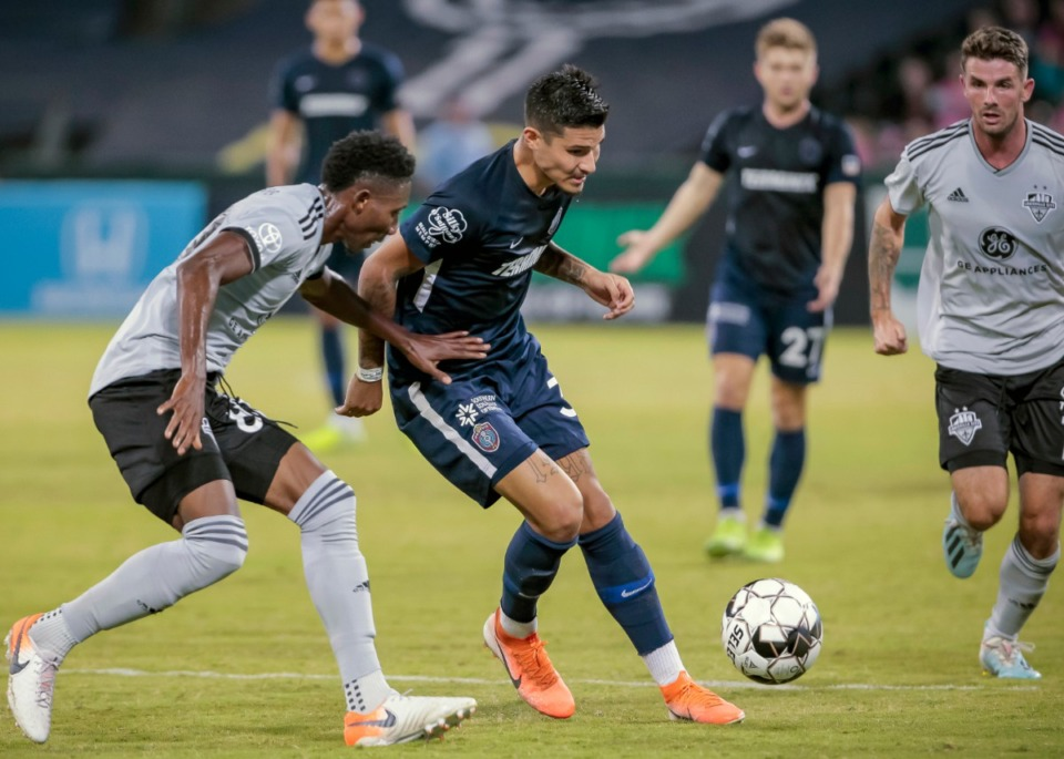 <strong>Pierre Da Silva (center) plays against Louisville City FC in October 2019. The United Soccer League Championship has voted to continue the 2020 season.</strong> (Frank Ramirez/Daily Memphian
