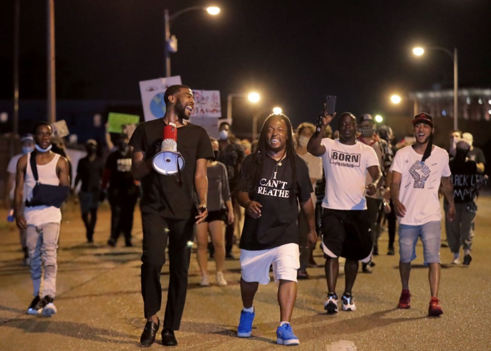 <strong>Darin Abston Jr. and Frank Gottie march down Second Avenue June 4, 2020, for the ninth day of protests over the death of George Floyd.</strong> (Patrick Lantrip/Daily Memphian)