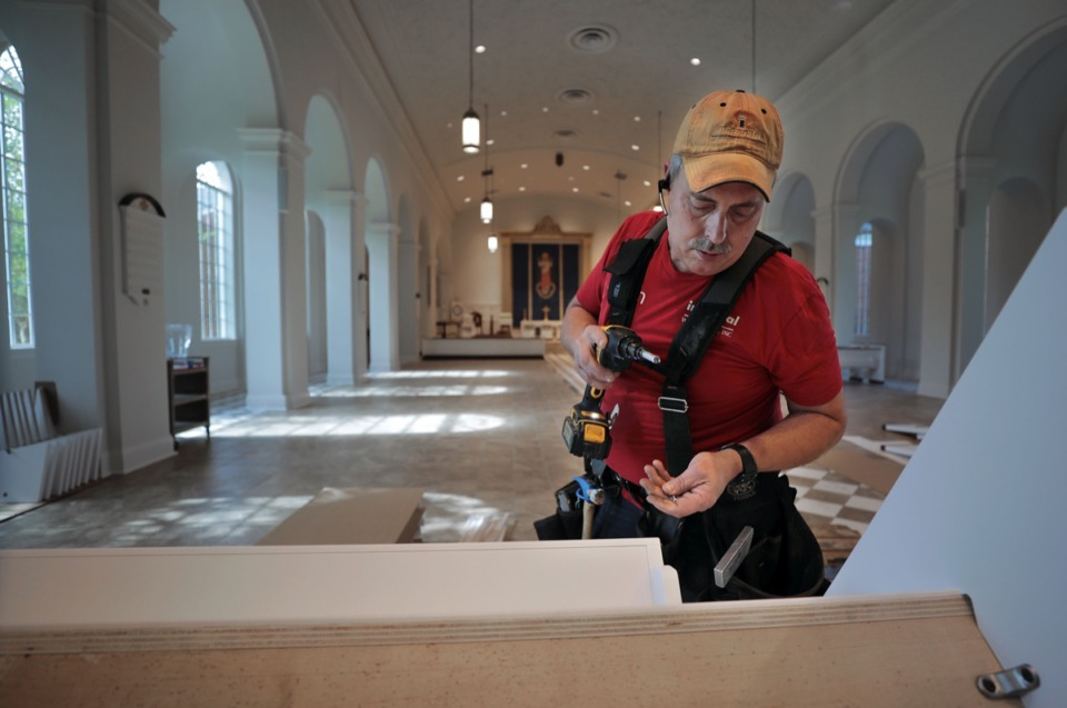 <strong>Kevin Smith of Texas-based Imperial Woodworks assembles a new pew that is being installed at the Church of the Holy Communion in East Memphis May 26, 2020.</strong> (Patrick Lantrip/Daily Memphian)