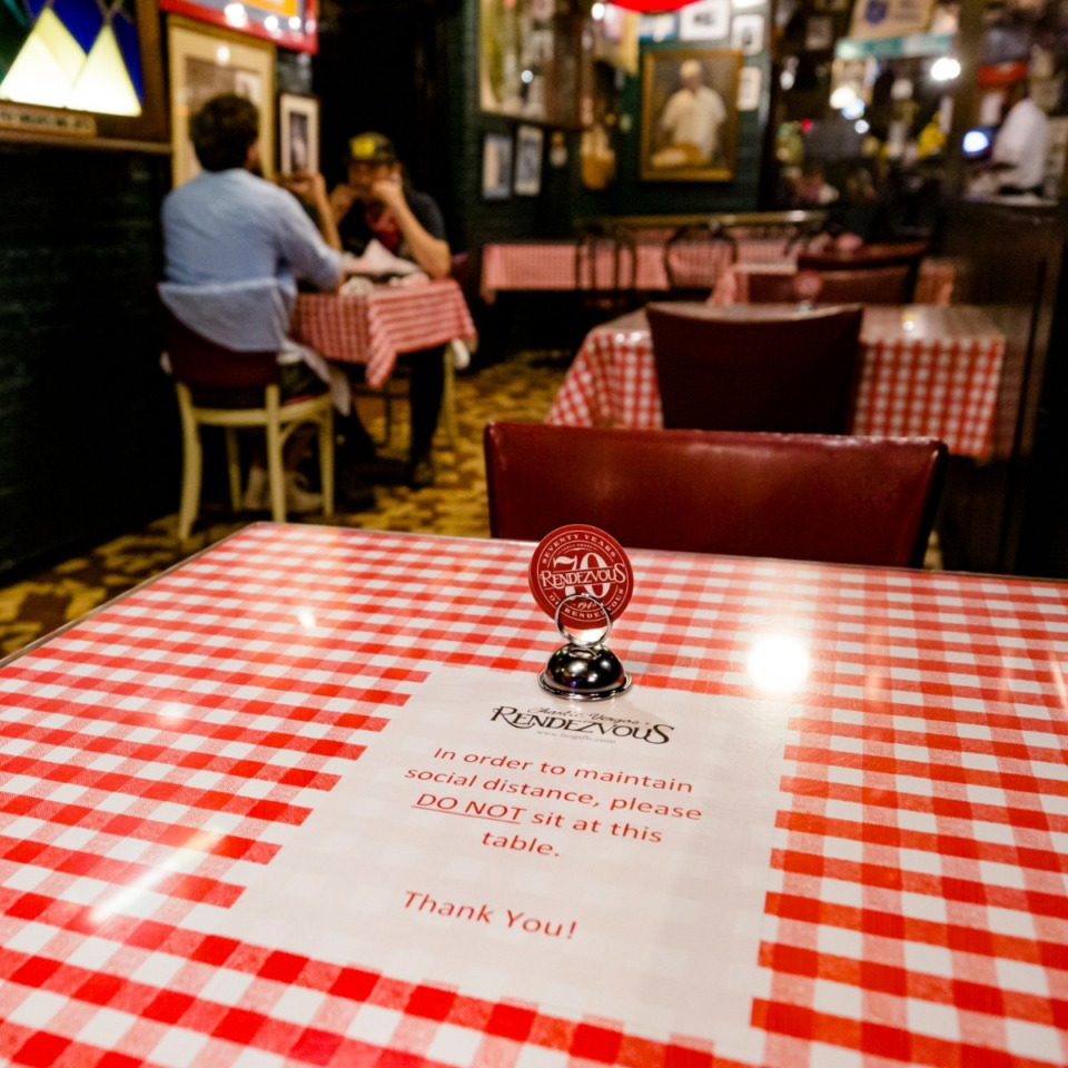 <strong>A 6-foot-distance sign stands on a table at Rendezvous restaurant in Downtown on June 5, 2020.</strong> (Ziggy Mack/Daily Memphian)