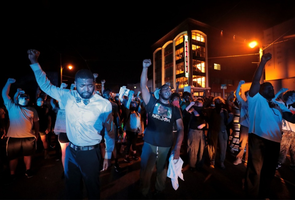 <strong>A group of Memphis protesters, some without masks, raise their hands in solidarity on June 3, 2020, the eighth day of protesting over the murder of George Floyd.</strong> (Patrick Lantrip/Daily Memphian)