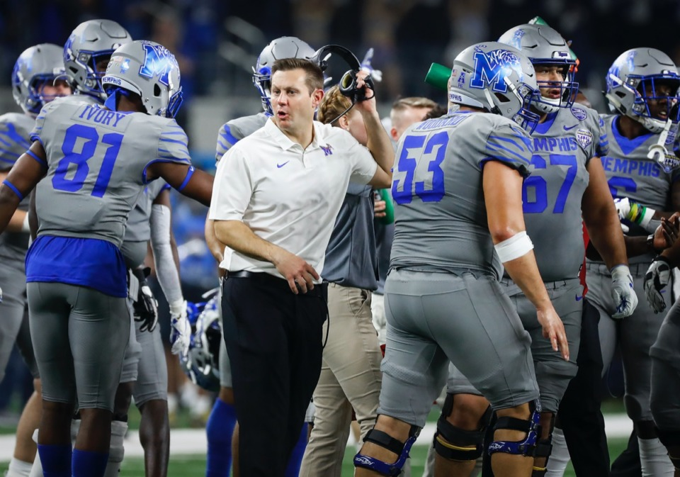 <strong>Memphis head coach Ryan Silverfield (middle), now planning his team's return to campus, is pictured here during a break in action against Penn State at the Cotton Bowl Saturday, Dec. 28, 2019 at AT&amp;T Stadium in Arlington, Texas.</strong> (Mark Weber/Daily Memphian file)