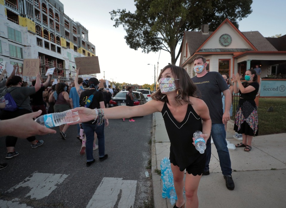 <strong>Workers from Restaurant Iris pass out water to thirsty protesters June 6, 2020 during the eleventh day of protesting over the death of George Floyd.</strong> (Patrick Lantrip/Daily Memphian)