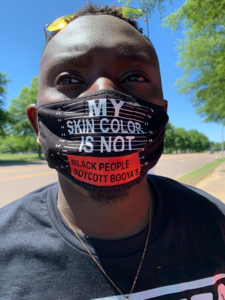 <span><strong>Romero Malone shows off his mask. He organized an event that drew about 20 protestors outside of Poplar Market Plaza June 6, 2020.</strong> (Abigail Warren/Daily Memphian)</span>