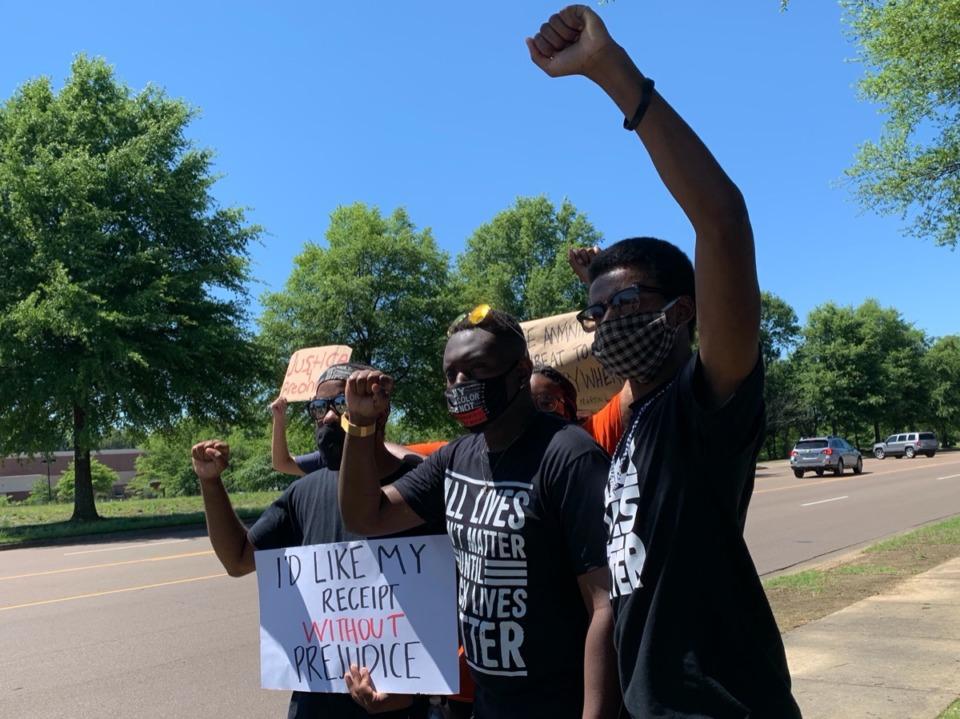 <span><strong>Derrick Gray (left), Romero Malone (center) and Justin J. Pearson (right) attended a rally on Market Boulevard in Collierville June 6, 2020. The protest against social injustice and racial inequality was the first in Collierville since George Floyd's death.</strong> (Abigail Warren/Daily Memphian)</span>